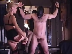 Blonde domina kicks tied slave's balls and belly during extreme bondage session
