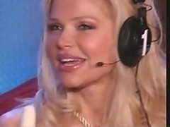 Pretty blond takes off panties in Howard TV studio