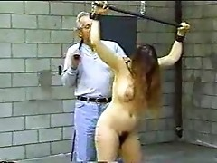 Julia is tightly bound and leathered being roped!
