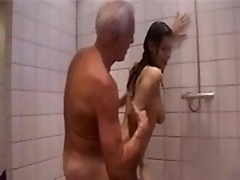 Pretty brunette gives older man blowjob then gets fucked from behind in shower