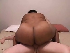 Black fat mama is pounded hardly by a white guy