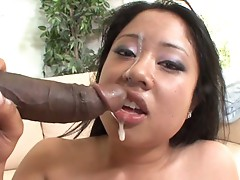 Kya Tropic slurps up a big black cock and gets her just reward