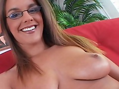 Sexy spectacled babe takes a black pole