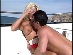 Hunky yachtsman seduces blond passenger on board