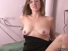 Hot housewife plays on top of washing machine