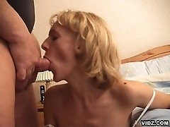 Nasty blonde oldy face smothered with lots of cum