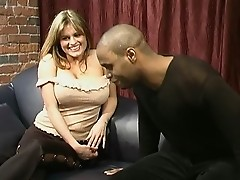 Big tits, big black cock, black condom