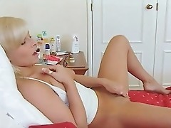 Nice blond girl explore a room and find a sextoy.