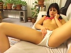 Brunette chick blows lubed cock