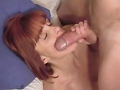 Big Tit Redhead gets messy facial cum load