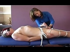 Brunette is binding man and jerking off his guy