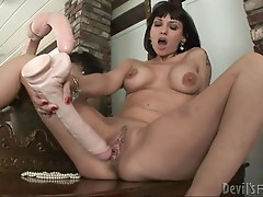 Carrie Ann shoves a huge toy up her stretchy snatch