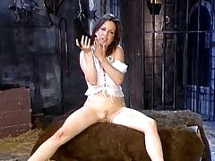 Kira Reed taking her clothes off in the dungeon