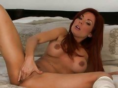 Jadra Holly on bed with long socks fingering