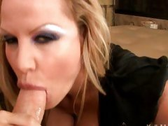 Kelly Madison wraps her juicy lips around ridged shaft