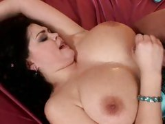 Busty Shione Cooper titty fucking a big dick with her real big tits
