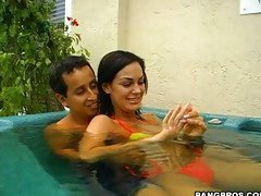 Angelina Valentine relaxes in the hot tub with a lucky friend