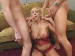 Blistering Nikki Hunter slobbers over two hard dicks