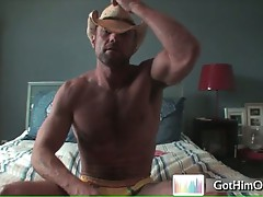 Muscled cowboy busting his nuts