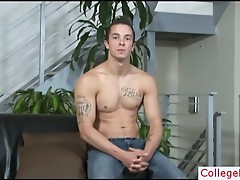 Muscled college guy stripping