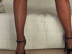 Blonde slut sensually masturbating in her fishnet stockings