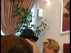 Slutty blonde fucks cowboy on a couch!