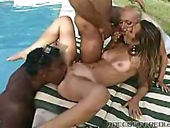 Poolside interracial sex in this foursome
