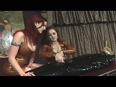 Slave man wrapped in black plastic wrap tortured by 2 mistresses