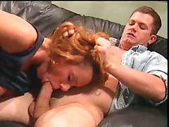Redhead gives his thick cock a hot blowjob