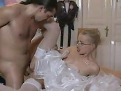 Beautiful blonde bride in glasses fucked