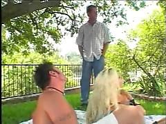See a bimbo take two dicks outdoors