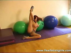 Busty flexible girl spreading