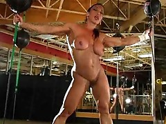 Incredibly muscular girl strips in boxing gym