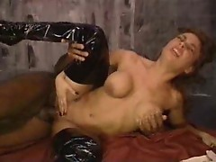 Girl in shiny boots goes for black cock