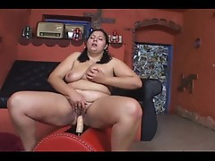 Fat girl rides a dildo machine