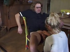Sexy blonde handling and blowing his cock