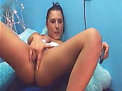 Busty brunette babe in white lingerie masturbates
