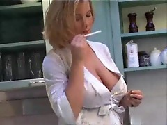 Amazing big tits on the smoking housewife