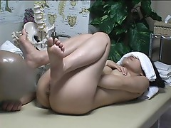 Elegant Japanese girl is banged on massage table