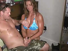 Busty bikini girl giving a great handjob