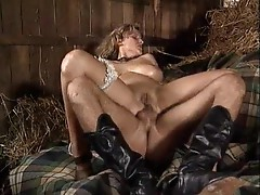 Two cocks fuck a slut in the barn