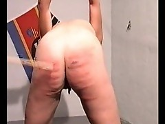 Caning her ass leaves painful marks