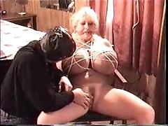 Huge tits girl in bondage is toyed
