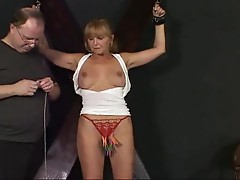Mature woman suffers pain in BDSM scene