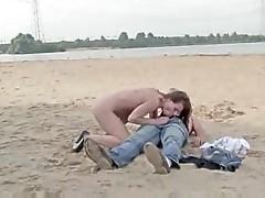 Naked girl sucks him and rides him at beach