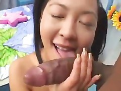 Asian slut Liliane gets a large black dick in her tiny ass