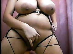Big plumper blonde with huge tits is fingering herself on her webcam