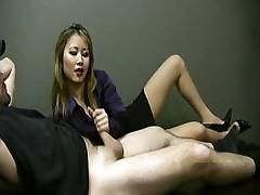Lucky employee gets a handjob from lady boss