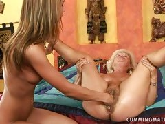 Hot grandma teaches a young girl how to eat grannie's wet pussy.