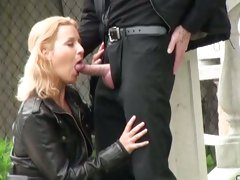 A hot blonde is so horny that she gets on her knees at a park and sucks a cock